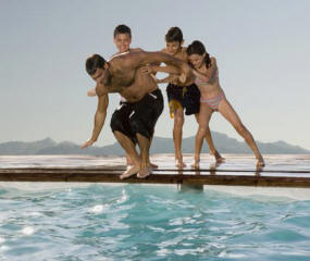 picture of latino family fun at swimming pool