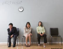 stock photo of bored people in waiting room - ethnic people