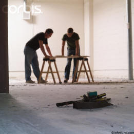 stock picture of two construction workers going over house plans