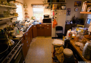 picture of a cluttered kitchen - a stock photo
