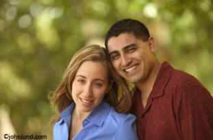 Ethnic stock photo of a happy hispanic couple smiling at the camera
