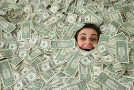 Picture of a woman buried in money