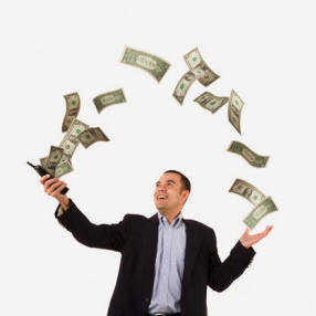 Ethnic business man with money flowing from his cell phone