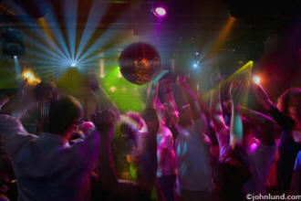 Lifestyle stock photo of people dancing in a night club
