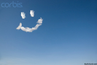background stock photo of a sky with a smiley face made of clouds