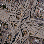 aerial view of a freeway interchange to illustrate complexity