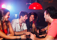 picture of group of happy friends drinking at a bar
