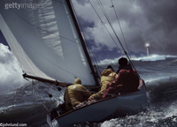 stock photo of a sailboat in a storm representing safety