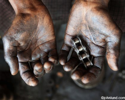 Tom Hodges Auto >> Close up of Asian Man's Hands Holding Greasy Roller Chain Parts
