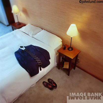Businessman S Motel Or Hotel Room With Clothes On Bed