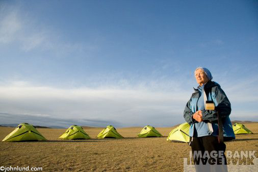 Pictures Of Active Senior Woman With Tents Adventure