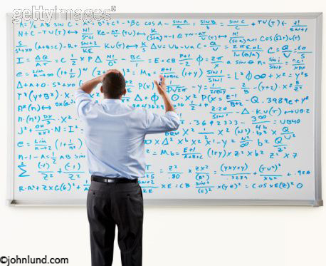 Man Working On Complex Math Formula On Whiteboard