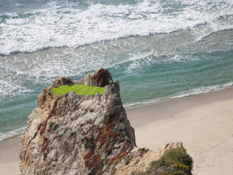 Photos of a golf course green in an impossible to reach location high atop a rock formation on the ocean beach.
