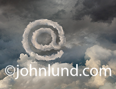 The @ symbol is made of clouds, and residing in the cloud in this image about cloud computing, the Internet and email addresses.