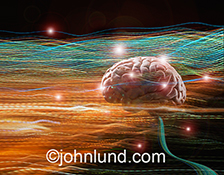 An active human brain is pictured amind streaking colored lights in a stock photo about brain research, communicatins, creativity and artificial intelligence.