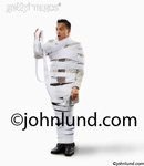 Picture of a businessman, a CFO, Accountant, or financial manager,  wrapped in adding machine tape in a humrous look at finance issues.