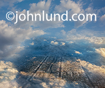 This dramatic aerial view of a city through the clouds makes a great metaphor for a wider range of concepts from cloud computing to drone use to weather issues.