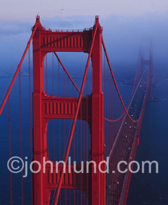 Beautiful Stock picture of the Golden Gate Bridge  take from a helicopter as the fog moves in on the South Tower.
