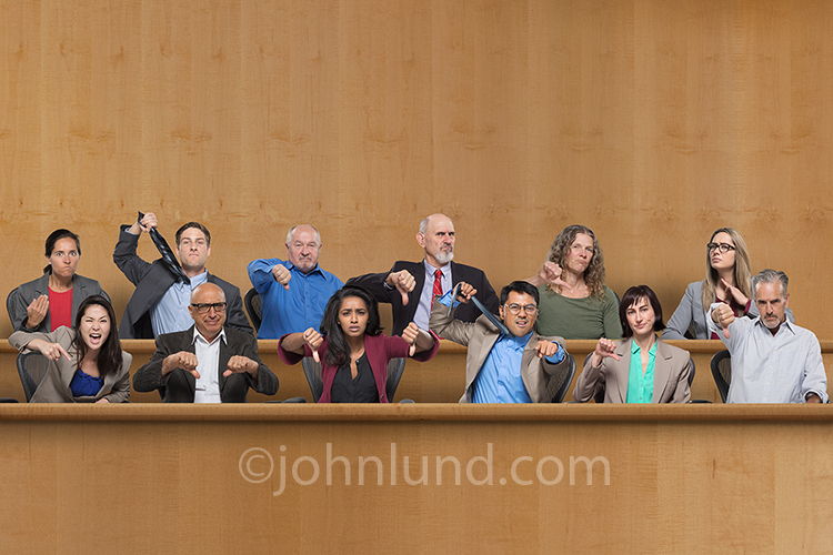 Stock photo of an angry jury showing their guilty verdict by gestures and facial expressions.