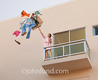 An angry woman throws a man's belongings over a balcony in an image about relationship difficulties and breaking-up.