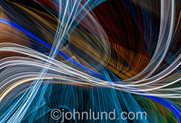 Colorful light streaks form a pattern of an architectural nature in this dynamic and colorful stock photo filled with energy and motion.