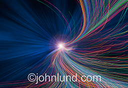 An intricate panoply of streaking colored lights zoom towards the viewer in this vivid and dynamic stock photo about streaming data and networking and bandwidth issues.