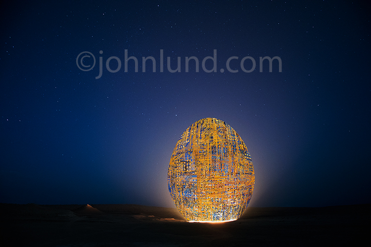 The birth of technology is just one of many tech concepts artfully illustrated in this futuristic egg created from computer circuits and resting in a mysterious landscape.