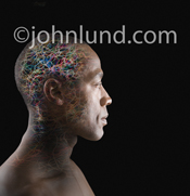 Picture of a man's head filled with colored light trails indicating connections, synapses, neurons and creative activity.