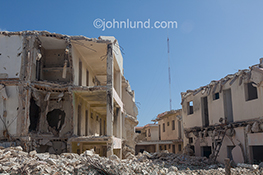 Destroyed buildings and rubble indicated destruction and renewal in a stock photo.