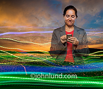 A business woman uses a mobile device to stay connected in this stock photo about business on the go, smart phone uses, and wireless communications technology.