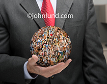 A globe of portraits representing social media rests in the palm of a businessman's hand in this image about business and social media on a global level.