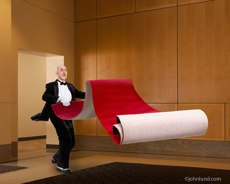 A butler rolls out a red carpet in a metaphorical photo for service of the highest order.