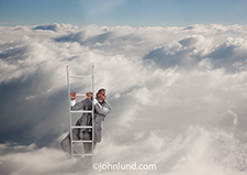 An African American executive in a double breasted suit climbs a ladder up through the clouds in his efforts to attain success, or perhaps move his company to