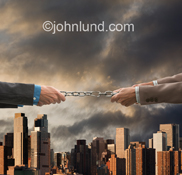 Two executives pull on each end of a chain in a photo about business competition, weak links and Challenge.