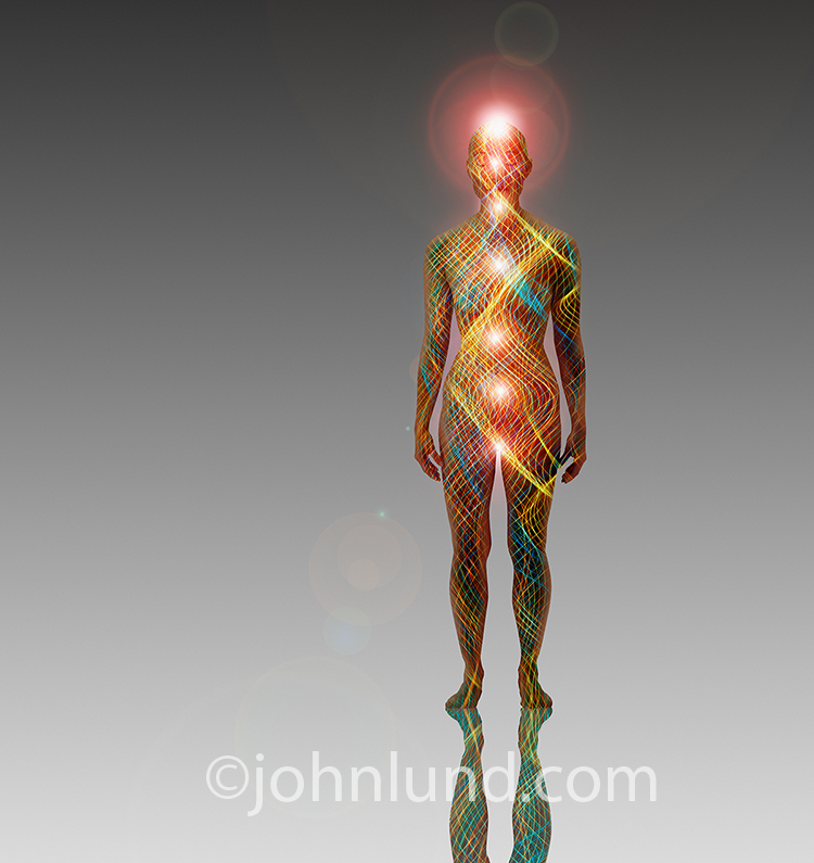 A woman is filled with lines of energy and glowing chakras in this stock photo about alternative medicine, energy work and spirituality.