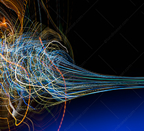 Big data chaos control is the theme of this stock photo featuring a complex tangle of light trails forming into an organized stream of information.
