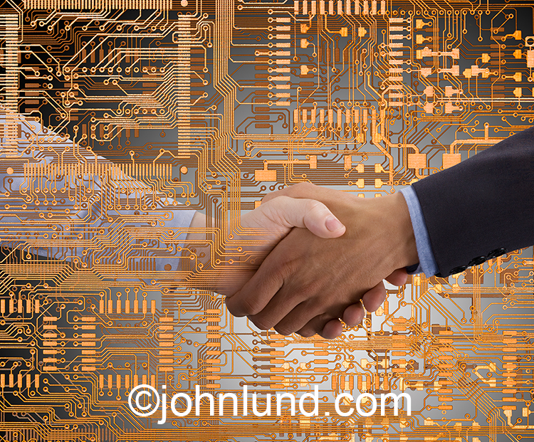 Computer circuitry connections are demonstrated in this stock photo of a handshake emerging from a circuit board.