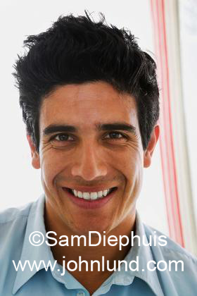 Portrait of a average looking Hispanic man smiling at the camera. Picture of a typical hispanic man.