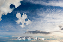 A cloud takes on the shape of a jig saw puzzle piece in a stock photo about cloud computing.