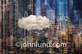A single, solitary cloud floats in front of a abstract urban background in a stock photo about cloud computing, connections and online business networks.