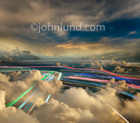 Cloud computing and wireless communications are illustrate with this photo of colored streaks of light coursing through a high-altitude cloud cover.
