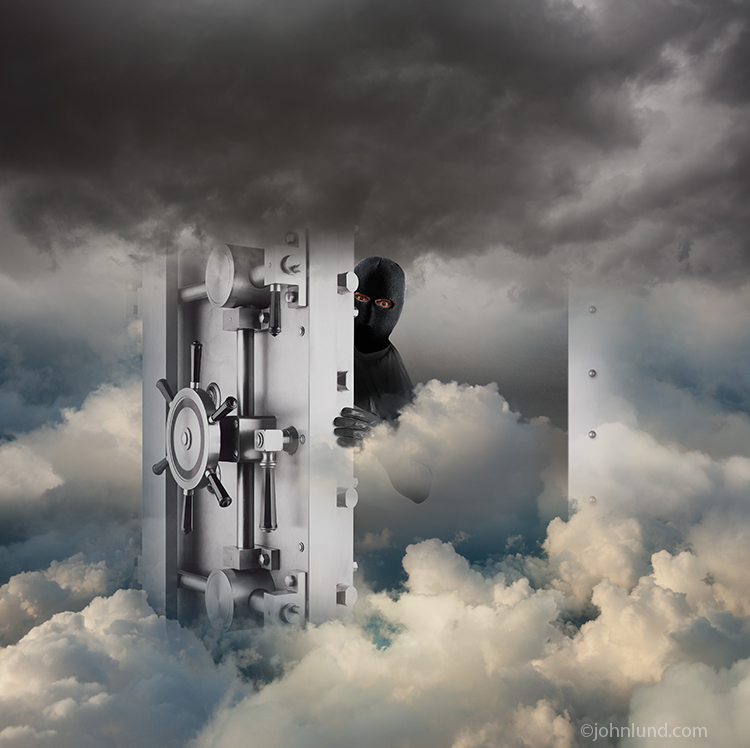 "A vault door opens in a cloudscape with a shadowing figure wearing a mask peering out from behind in a photo about security in ""the cloud"" and cyberspace."
