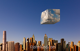 Cloud computing is illustrated in this stock photo of a cube of clouds suspended over a city skyline made up of buildings from Buenos Aires, Hong Kong, and New York.