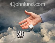 The gamble and risk of cloud computing is demonstrated with this stock photo a hand tossing a pair of dice in the clouds in a stock photo about the dangers of cloud computing.