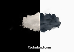 The pros and cons of cloud computing are indicated in this stock photo featuring a cloud, half black and half white, on a half white and half black background, a very yin and yang of online computing.