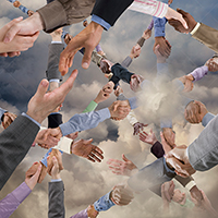 Dozens of handshakes join each other in the cloud in a unique stock photo about cloud computing, connections in the cloud, and innovation in communications technology.