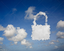 Cloud security in cloud computing is shown in this stock photo of a padlock formed from clouds in a summer sky.