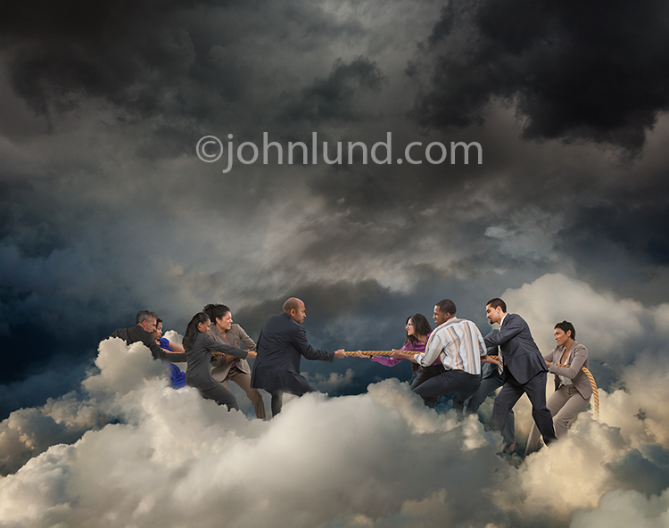 A tug of war in the cloud is a visual metaphor for competition and teamwork in the cloud.