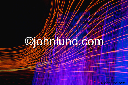 Abstract streaks of light form a concept stock photo showing speed, motion, energy and communications.  Red streaks of red light and bluish haze. Pictures of energy.