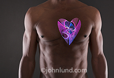 A complex and intricate light pattern takes the shape of a heart and is visible within a man's torso in this image that brings visual impact to ideas, concepts and issues that deal with both the physical heart and the emotions associated with the human he